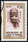 """IVORY COAST - CIRCA 1960: A stamp printed in Ivory Coast from the """"Native Masks """" issue shows Bete Mask, circa 1960. — Stock Photo"""