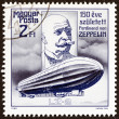 Постер, плакат: HUNGARY CIRCA 1988: A stamp printed in Hungary issued for the 150th birth anniversary of Ferdinand von Zeppelin shows Zeppelin and Airship LZ 2 circa 1988