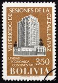 """BOLIVIA - CIRCA 1957: A stamp printed in Bolivia from the """"The 7th Latin America Economic Congress, La Paz """" issue shows Congress Buildings Santiago de Chile and La Paz, circa 1957. — ストック写真"""