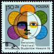 POLAND - CIRCA 1978: A stamp printed in Poland issued for the 11th World Youth and Students Festival, Havana shows Globe containing Face, circa 1978. — Stock Photo #78738550