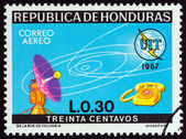 """HONDURAS - CIRCA 1968: A stamp printed in Honduras from the """"100th Anniversary International Telecommunications Union """" issue shows dish aerial and telephone, circa 1968. — Stock Photo"""