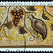 CYPRUS - CIRCA 1970: A stamp printed in Cyprus issued for the 50th General Assembly of International Vine and Wine Office shows Grapes and Partridge mosaic, Paphos, circa 1970. — Stock Photo #84131336