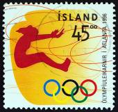 """ICELAND - CIRCA 1996: A stamp printed in Iceland from the """"Olympic Games, Atlanta """" issue shows Long jumping, circa 1996. — Stock Photo"""