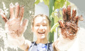 Funny girl with dirty disposable gloves — Stock Photo