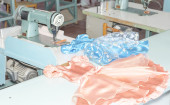 Children's dress sewn on sewing machines — Stock Photo