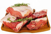 Raw meat with spices — Stock Photo