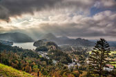 Alps in Bavaria with sunny beams against lake in Germany — Stock Photo