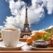 Coffee with croissants against Eiffel Tower in Paris, France — Stock Photo #57473789