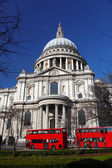 St. Paul's Cathedral with red double-decker in London, England — Stock Photo