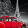 Eiffel Tower with old red car in Paris, France — Stock Photo #70148853