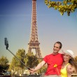 Couple Taking Selfie by Eiffel Tower in Paris, France — Stock Photo #70711951