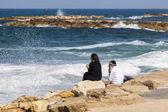 Couple at the seashore enjoys the view. Tel Aviv, Israel — Стоковое фото