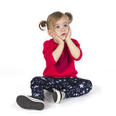 Baby girl sitting and make a gesture with hands — Stock Photo