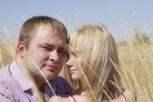 Young man embracing a beautiful girl — Foto de Stock