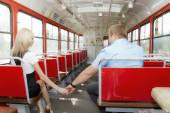 Young guy to get acquainted with a cute girl in the tram — Stock Photo