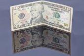 A ten-dollar bill on a reflective surface — Stock Photo