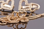 Gold jewelry in the shape of hearts — Stock Photo