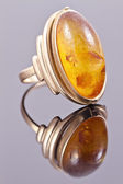 Old gold ring with inset amber — Stock Photo