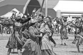 Dancing in national costumes at the celebration of Sabantuy — Stock Photo