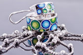 Silver jewelry with colored enamel and silver chain — Stock Photo