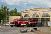Fire trucks are in full readiness on the ground in front of the — Stock Photo