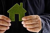 Senior man holding green icon house concept — Стоковое фото