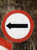 Street sign turn Left on the wall — Stock fotografie