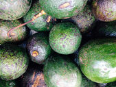 Fresh avocados background — Стоковое фото