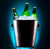 Beer bottles in ice bucket — Stock Photo