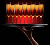 Waiter hand with champagne — Stock Photo