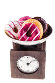 Scale with donuts — Stock Photo