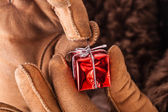 Unwrapping christmas gift — Stock Photo