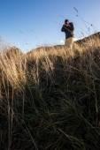 Trekker with camera — Stock Photo