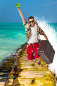 Man jumping over the waves — Stock Photo