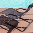 Pool side chaise lounge — Stock Photo #66917375