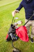 Player picking a golf club — Stock Photo