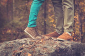Couple Man and Woman Feet in Love Romantic Outdoor with Autumn season nature on background Fashion trendy style — Stock Photo