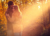 Young Couple Man and Woman Hugging and Kissing in Love Romantic Outdoor — Stok fotoğraf