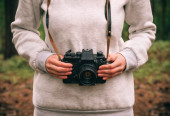 Woman hands holding retro photo camera outdoor Lifestyle nature on background — Stock Photo