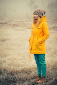 Young Woman standing alone outdoor Travel Lifestyle and melancholy emotions concept — Stock Photo