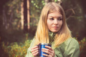 Young Woman with metal touristic tea cup Outdoor Lifestyle and Hiking concept — Stockfoto