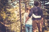 Young Couple Man and Woman Hugging in Love Romantic Outdoor with forest nature on background Fashion trendy style — Stock Photo
