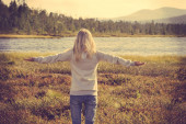 Young Woman relaxing outdoor hand raised Lifestyle vacations concept forest and lake on background trendy retro colors — Fotografia Stock