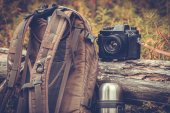 Lifestyle hiking camping equipment retro photo camera backpack and thermos outdoor — Stock Photo