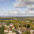 Постер, плакат: View of the private sector and the Volga River in autumn