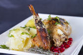 Braised rabbit with potatoes and thyme — Stock Photo