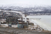 MAGADAN, RUSSIA - DECEMBER 22: Old Soviet barracks on the shores of the Sea of Okhotsk in Magadan on December 22, 2014 in Magadan. — Stock Photo