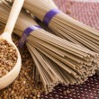 Wooden spoon about buckwheat and buckwheat noodles — Stock Photo #67505943