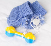 Rattle, pacifier and knitted booties for the newborn — Stock Photo