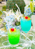 Summer fresh cocktail on table at garden — Stock Photo